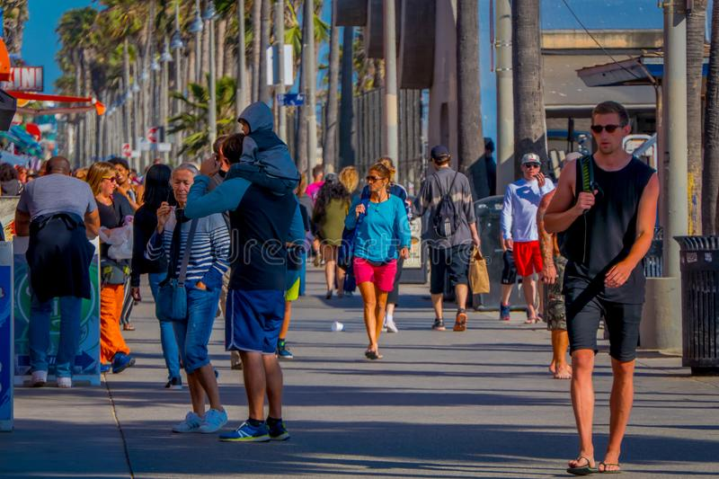 Los Angeles, California, USA, JUNE, 15, 2018: Outdoor view of unidentified people walk along the Venice Beach Boardwalk. On a sunny summer day in L.A royalty free stock photos