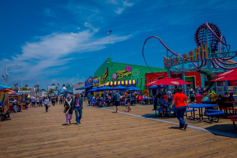 Los Angeles, California, USA, JUNE, 15, 2018: Unidentified people walking in a wooden pier in Santa Monica, at the end. Of Route 66. The amusement park is a royalty free stock photography