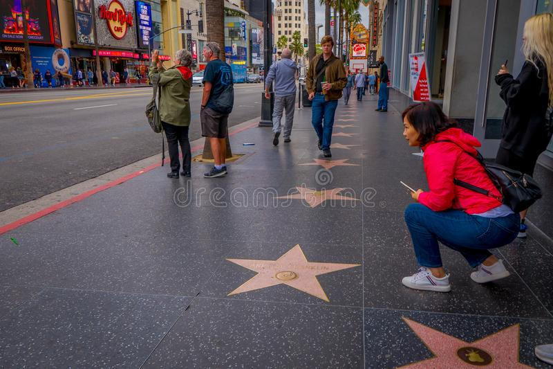 Los Angeles, California, USA, JUNE, 15, 2018: Unidentified tourists posing and taking pictures in walk of fame in Los royalty free stock photo