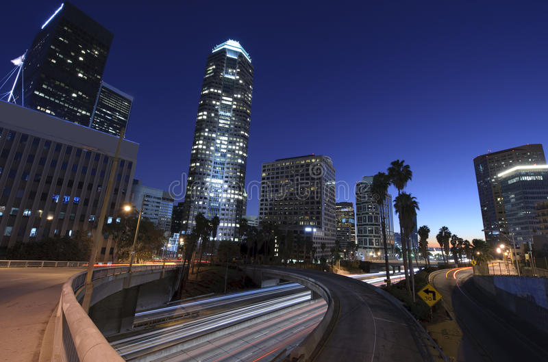 Los Angeles city skyline. And freeway at night stock photo