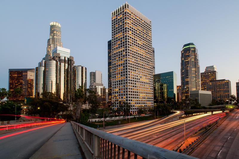 Los angeles city speed sunset. Traffic speeding through Los Angeles at dusk royalty free stock photo