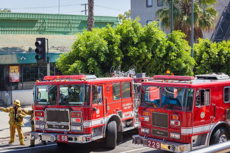 Los Angeles firemen at work with red fire trucks royalty free stock image