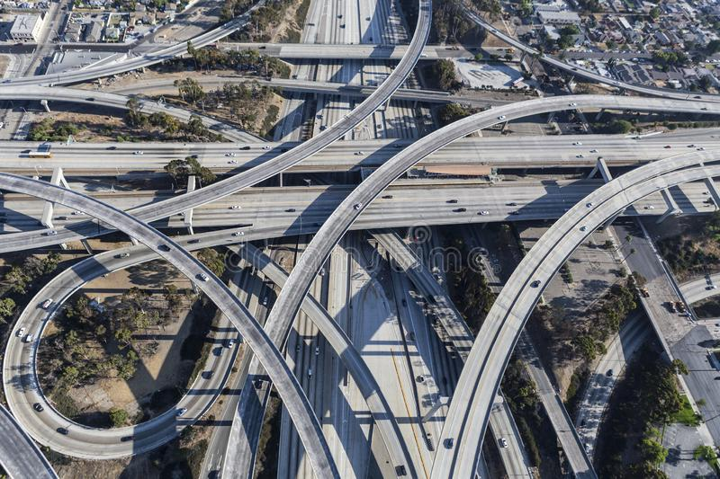 Los Angeles Freeway Ramps Aerial. Afternoon aerial view of ramps and traffic on the Harbor 110 and Century 105 freeway junction in Los Angeles County, California royalty free stock photo