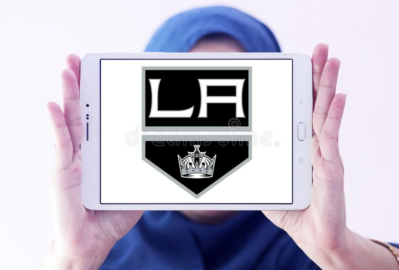 Los Angeles Kings ice hockey team logo. Logo of Los Angeles Kings ice hockey team on samsung tablet holded by arab muslim woman. The Los Angeles Kings are a stock photos