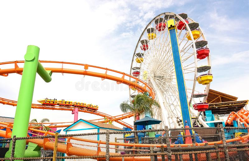 Side horizontal view of multicolored ferris wheel at Santa Monica Pier at Pacific Amusement Park - Los Angeles royalty free stock photography