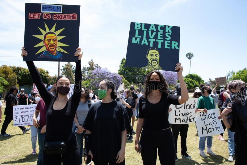 Protests Against Police Violence Over George Floyd Death. LOS ANGELES - MAY 30, 2020: Participants Of Protest March Against Police Violence Over Death Of George stock photo