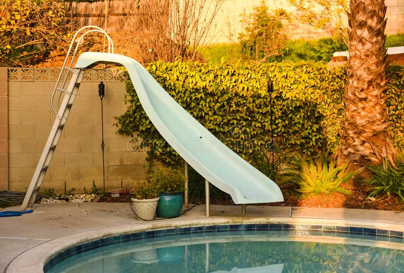 Los Angeles, California house backyard with pool and slide royalty free stock images