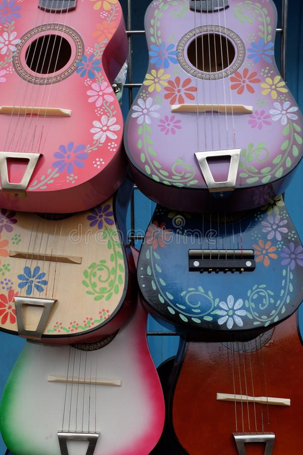 Beautiful painted guitars on display in the Old Town area of Olvera Street stock photography