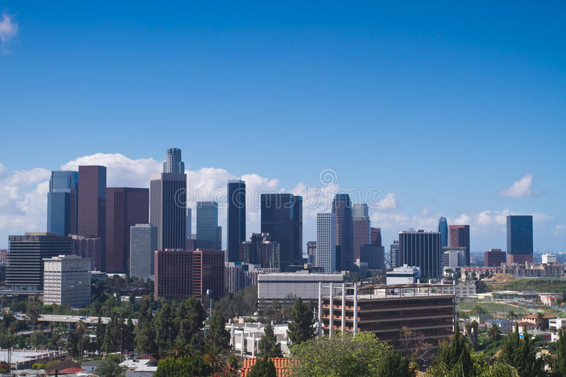 Los Angeles Skyline. Skyline of Los Angeles shown at early dusk with blue sky stock photography
