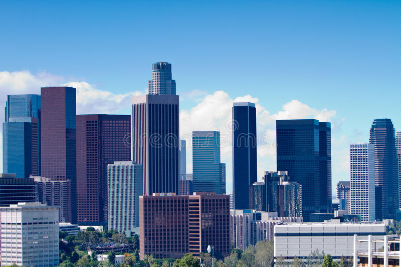Los Angeles Skyline. Skyline of Los Angeles shown at early dusk with blue sky royalty free stock photo
