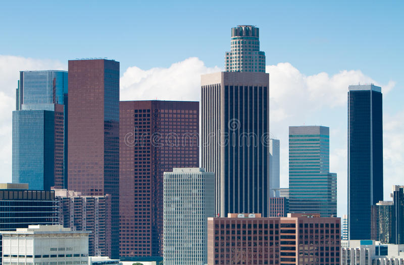 Los Angeles Skyline. Skyline of Los Angeles shown at early dusk with blue sky stock photo