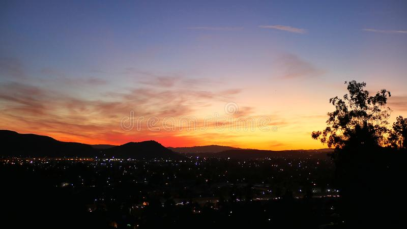 Los Angeles Sunset Over City Lights, Red Yellow and Blue royalty free stock image