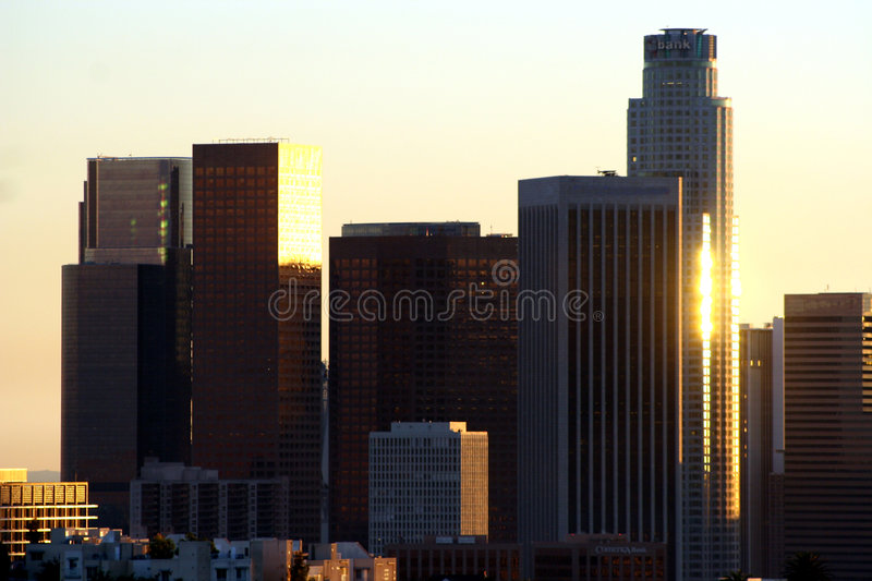 Los Angeles sunset skyline. Modern skyscraper buildings silhouetted at sunset, Los Angeles, California, U.S.A royalty free stock photo