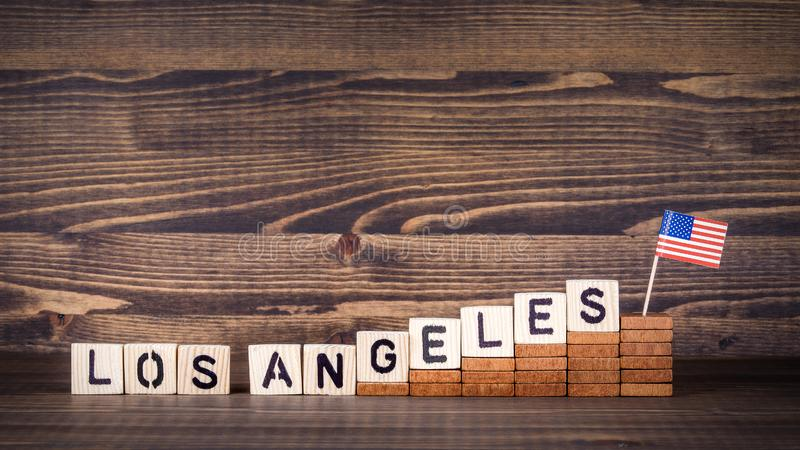 Los Angeles, United States. Politics, economic and immigration concept. Wooden letters and flag on the office desk royalty free stock images