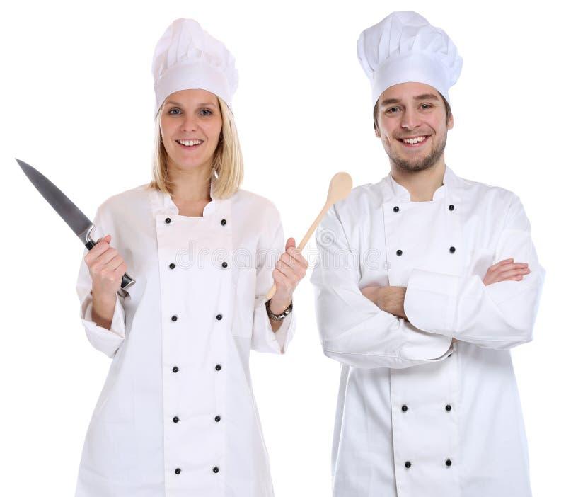 Los aprendices del aprendiz del aprendiz del cocinero cocinan cocinar con la cuchara del cuchillo imagen de archivo libre de regalías