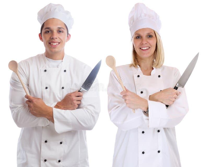 Los aprendices del aprendiz del aprendiz del cocinero cocinan cocinar con yo del trabajo del cuchillo foto de archivo libre de regalías