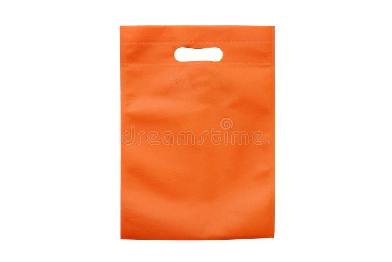 Los bolsos anaranjados, paño del eco empaquetan para reducir el calentamiento del planeta, panieres, la bolsa de plástico, recicl foto de archivo libre de regalías