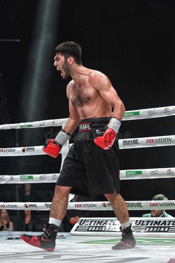 Los boxeadores Ramil Gadzhyiev y Bruno Sandoval luchan para el título de peso medio estupendo de plata internacional del consejo  fotos de archivo libres de regalías