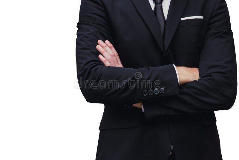 Los brazos de trabajo serios apacibles del hombre de negocios del encargado cruzan aislado imágenes de archivo libres de regalías