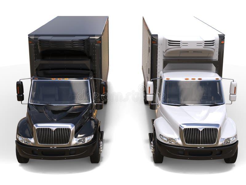 Los camiones blancos y negros del refrigerador - de lado a lado - rematan abajo de vista delantera fotos de archivo