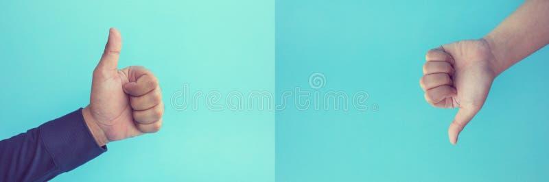 Los conceptos del resultado del efecto con el pulgar de la demostraci?n de dos manos para arriba presentan como y tienen aversi?n imágenes de archivo libres de regalías