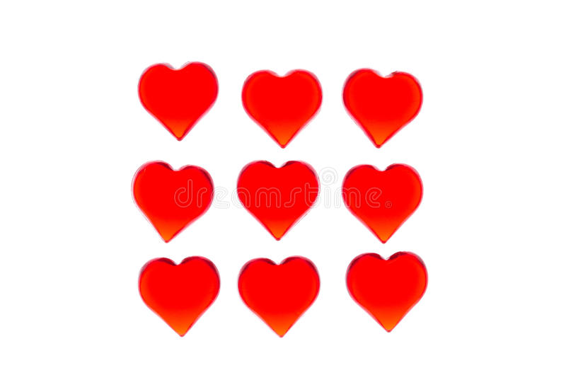 Los corazones rojos brillantes 9 juntan las piezas bajo la forma de cuadrado Para utilizar día del ` s de la tarjeta del día de S imagen de archivo
