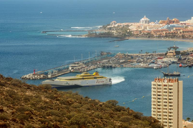 Los Cristianos view from Guaza mountain. Ferry to La Gomera leaving port bay. Tenerife, Canary Islands. Spain stock image