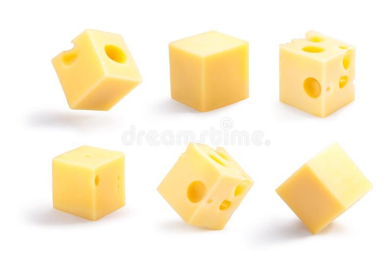 Los cubos Holey y llanos del queso fijaron, las trayectorias fotos de archivo