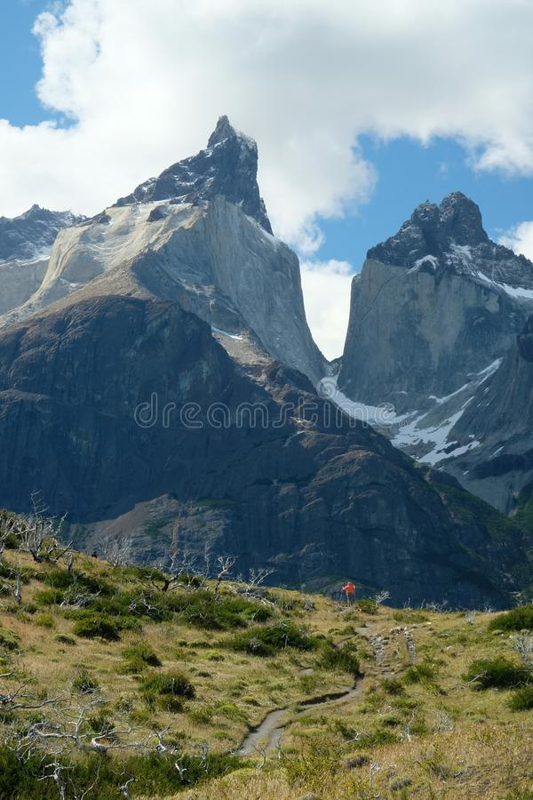 Los Cuernos in Torres del Paine with hiker, Patagonia, Chile royalty free stock image