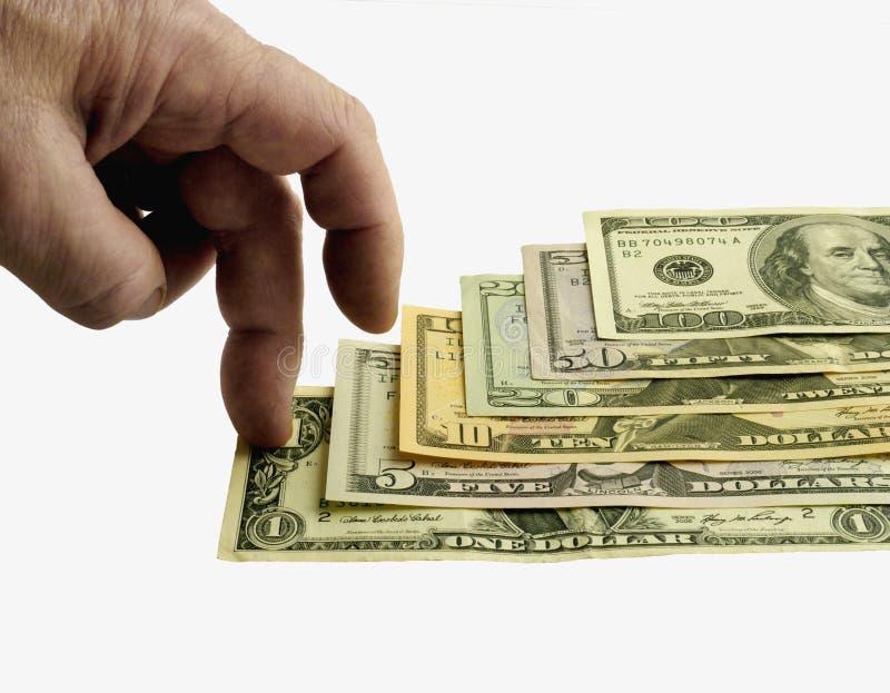 Los dólares de 1 a 100, los dedos intensifican. imagenes de archivo