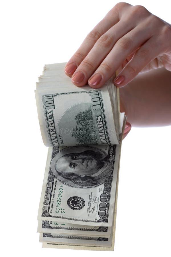 Los dólares están en manos. foto de archivo