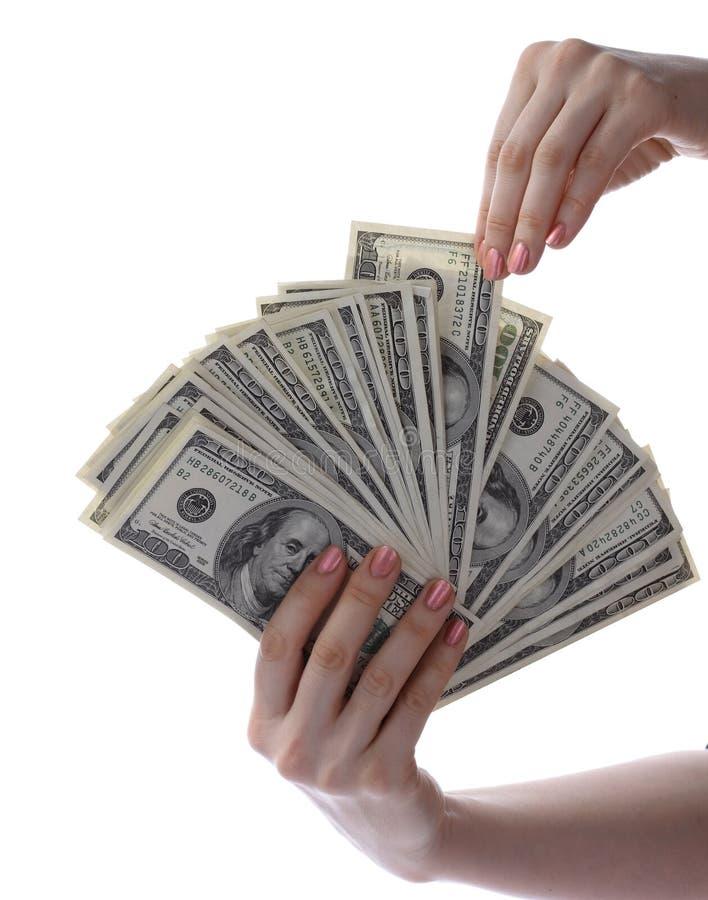 Los dólares están en manos. imagenes de archivo