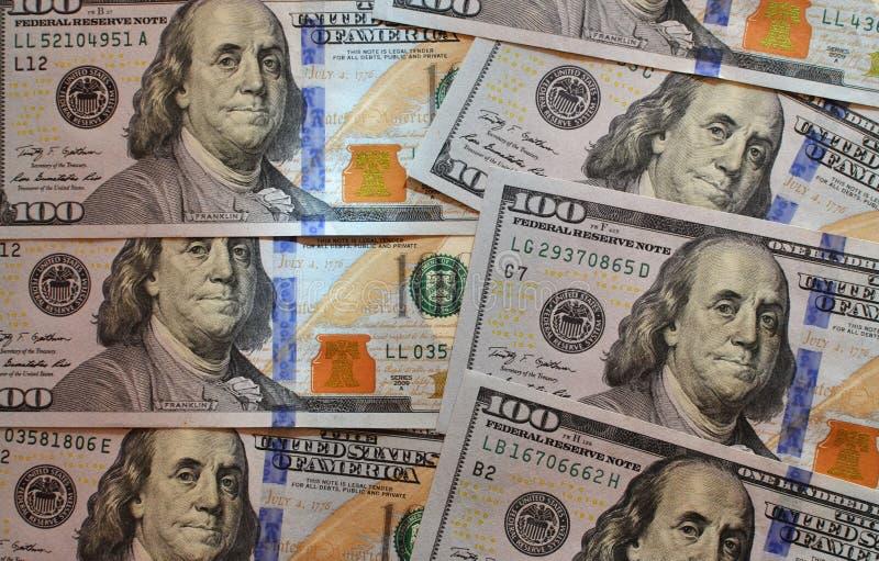 Los E Las notas de la textura del americano ciento del dinero diseñan Pluma, lentes y gráficos imágenes de archivo libres de regalías