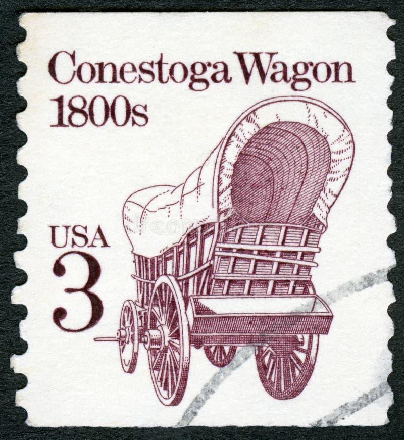 Los E.E.U.U. - 1987: 1800s del carro de Conestoga de las demostraciones, bobinas del transporte de la serie fotografía de archivo