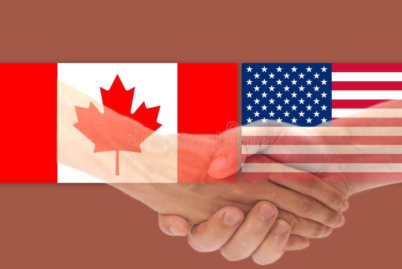 Los E.E.U.U. y bandera de Canadá con el apretón de manos fotos de archivo