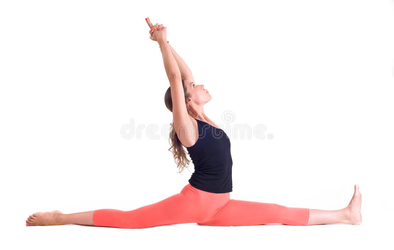 Los ejercicios practicantes/mono de la yoga presentan - Hanumanasana imagen de archivo