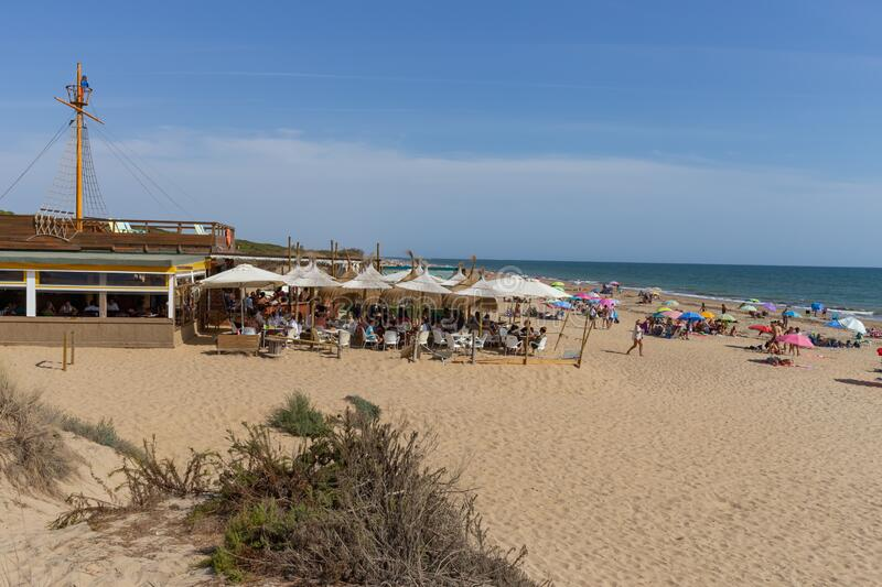 Los Enebrales beach in Punta Umbria, Huelva, Andalusia, Europe. A sunny summer day on vacation with lots of people and blue sky royalty free stock photos