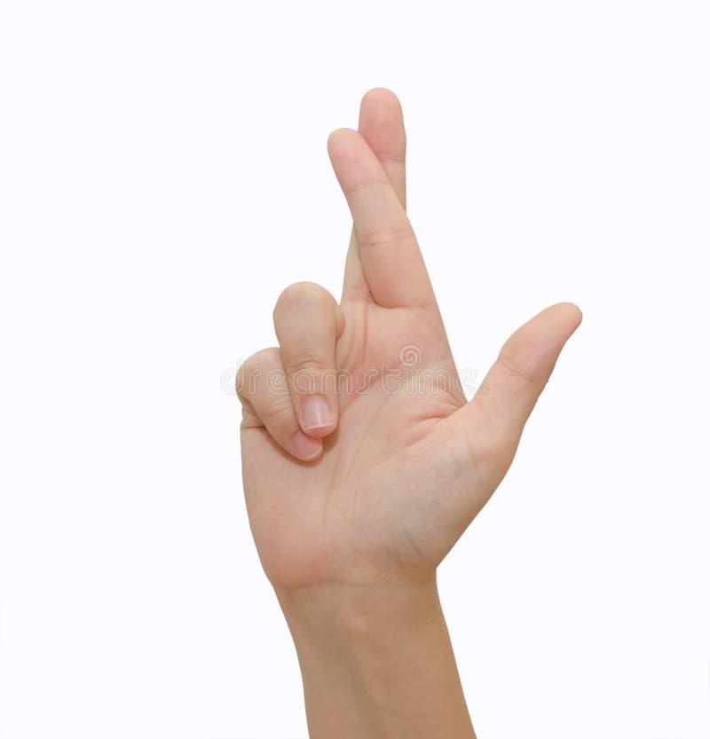 Los fingeres de un símbolo de la buena suerte que gesticulaban cruzaron la mano humana imagen de archivo