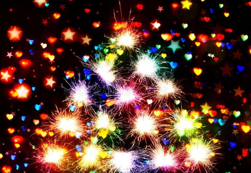 Los fuegos artificiales chispean Bokeh blured en las estrellas y el fondo de la oscuridad de los corazones imagenes de archivo
