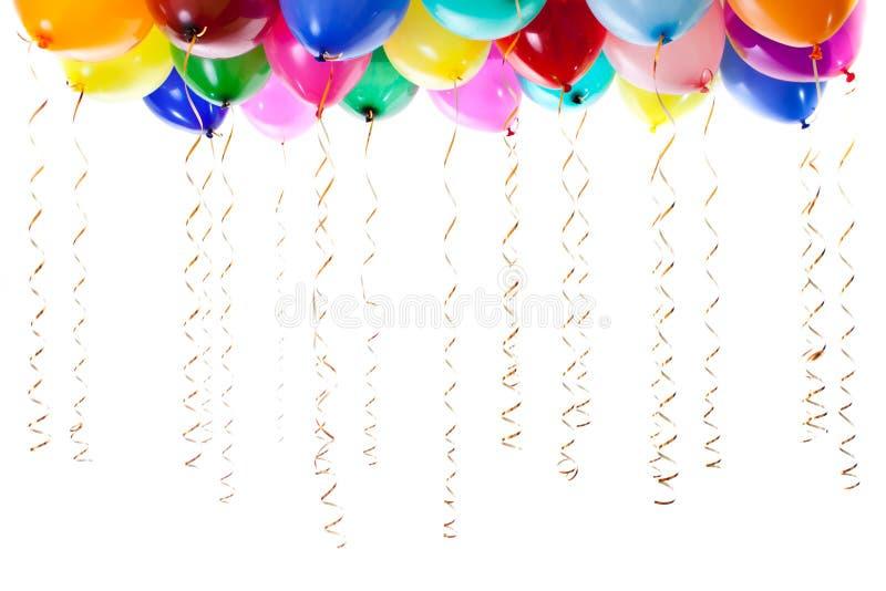 Los globos coloridos llenaron del helio aislado foto de archivo libre de regalías