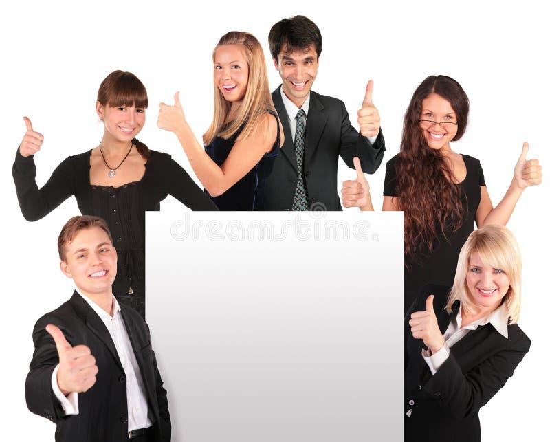 Los hombres de negocios agrupan con el papel para el texto foto de archivo