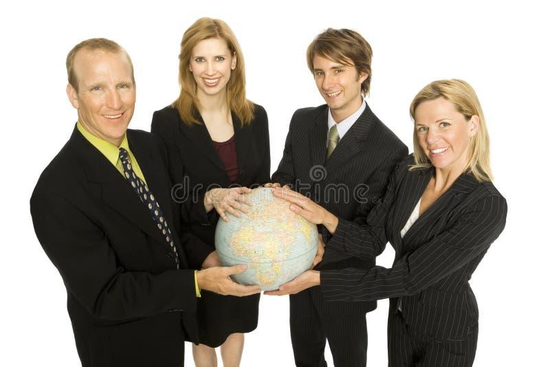 Los hombres de negocios sostienen un globo imagen de archivo libre de regalías