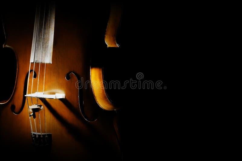 Los instrumentos musicales de la orquesta del violoncelo se cierran para arriba imagen de archivo