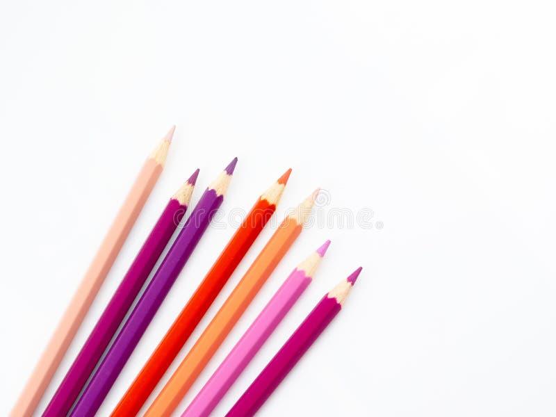 Los lápices multicolores con el espacio libre para el texto en el fondo blanco, lápices del color aislaron foto de archivo libre de regalías