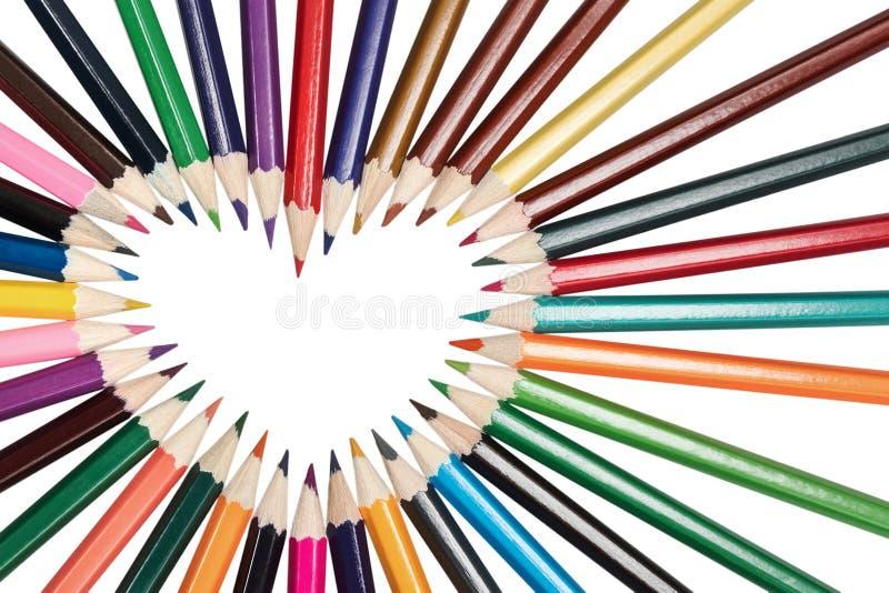 Los lápices se alinean en la forma del corazón fotografía de archivo libre de regalías