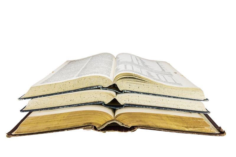 Los libros viejos abren la escuela apilada de la investigación aislada fotos de archivo libres de regalías