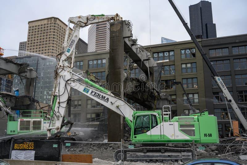 Los mand?bulas de la demolici?n del viaducto de Seattle chomp imagenes de archivo