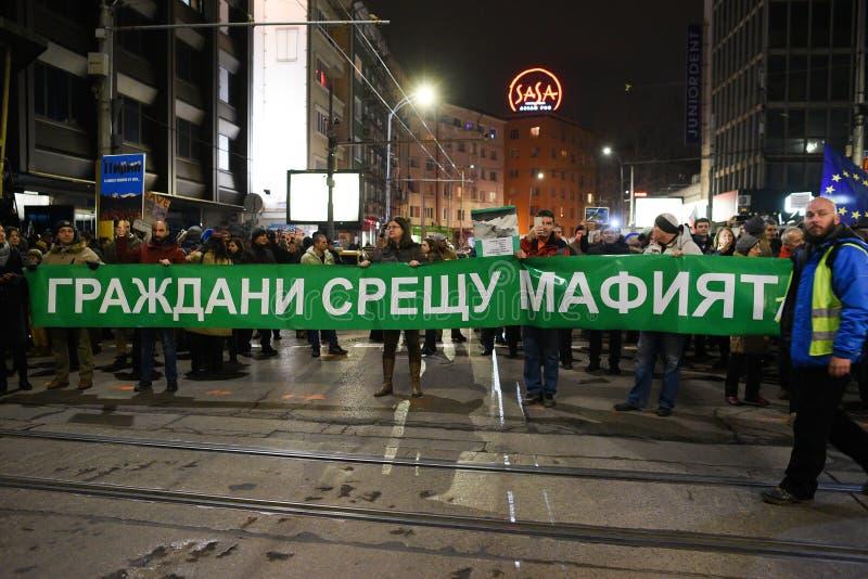 Los millares de búlgaros protestan contra planes del gobierno para ampliar el centro turístico de esquí de Bansko en el parque na fotografía de archivo libre de regalías
