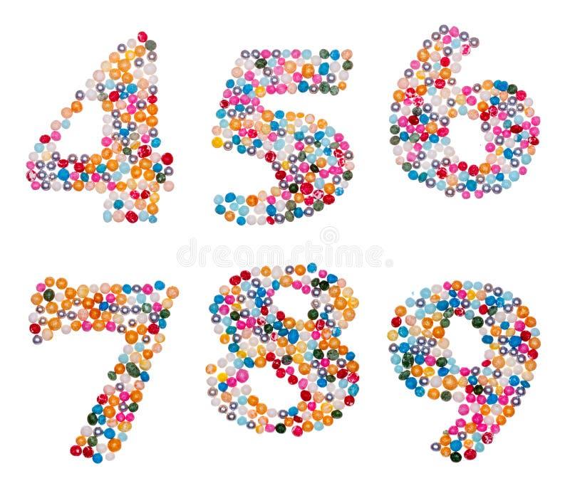 Los números hechos de colorido asperjan imagenes de archivo