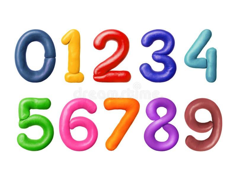 Los números se hacen del plasticine coloreado imagen de archivo